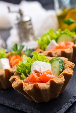 tartalets with cucumber salmon salad, tartalets with fresh salmon Stock Photo