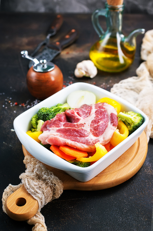 raw meat and fresh broccoli on a table 写真素材