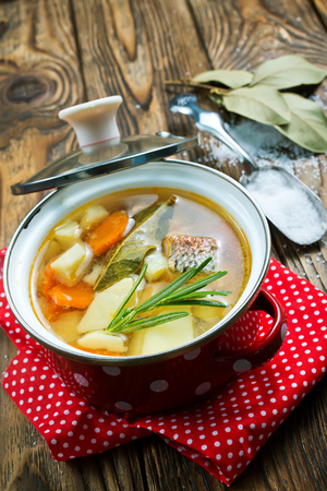 fish soup in bowl, fish soup with spice and greens