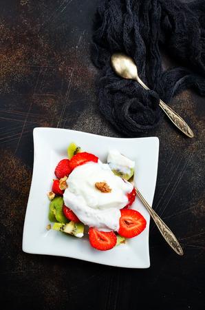 Fresh strawberry with banana kiwi and white cream. Organic food.