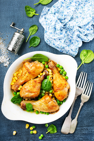 baked chicken legs with corn and green peas