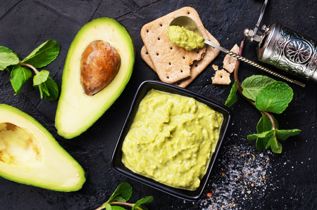 avocado sauce with lime in bowl, sauce in bowl