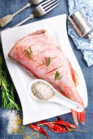 raw fish with aroma spice and salt, ocean perch on white plate Banco de Imagens