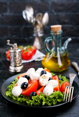 Vegetable salad on plate, greek salad, fresh salad with feta cheese