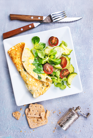 omelette with vegetable salad on the plate