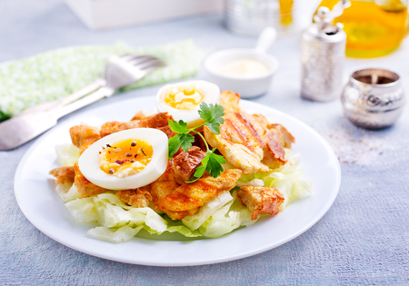 salad with vegetables and baked chicken