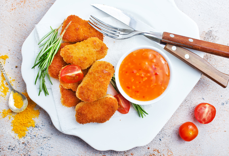 chicken nuggets with sauce, unhealthy food, stock photo Standard-Bild - 107483704