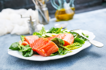 salmon with lemon and fresh spinach, diet food Stok Fotoğraf