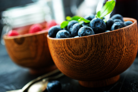 fresh raspberry and blueberry in bowl, fresh berries in bowl 写真素材