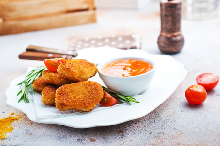 chicken nuggets with sauce, unhealthy food, stock photo