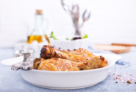 baked chicken legs with spica and fresh salad Reklamní fotografie