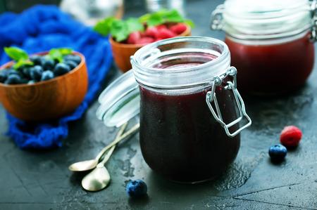 homemade jam in bank and fresh berries