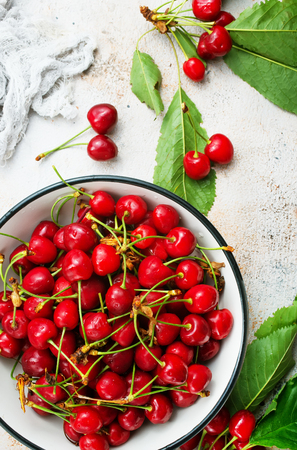 cherry in white bowl  on a table 写真素材