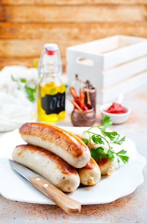 fried sausages with sauce on a table Standard-Bild - 108307260