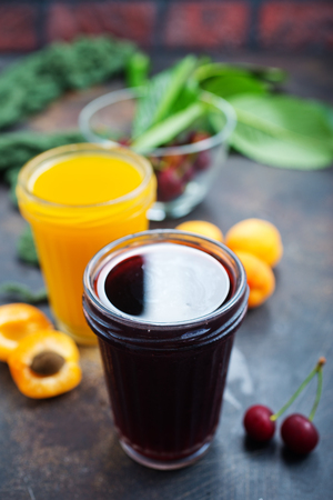 juice in glass, cherry and apricot juice