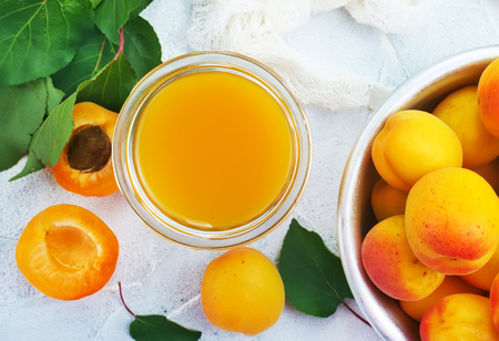 apricot juice in glass and fresh apricots Reklamní fotografie