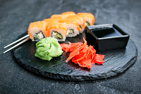 Sushi with chopsticks. Sushi roll japanese food on a table 스톡 콘텐츠