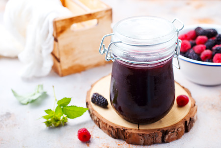 sweet jam from berries, jam and berries on a table Stockfoto