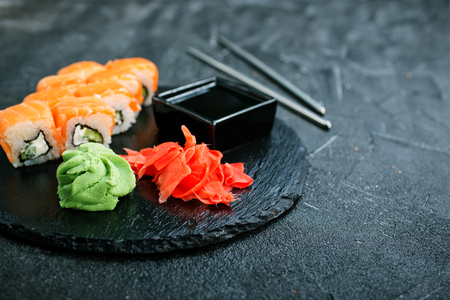 Sushi with chopsticks. Sushi roll japanese food on a table Stock Photo