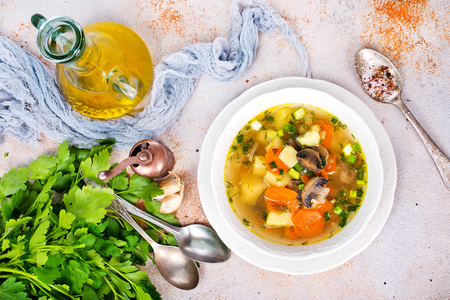Fresh soup with mushrooms in bowl, fresh vegetable soup