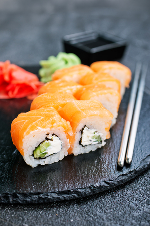 Sushi with chopsticks. Sushi roll japanese food on a table Stok Fotoğraf