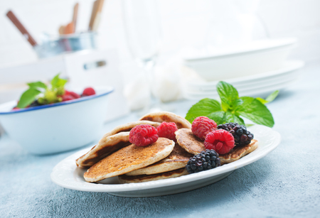 pancakes with fresh berries on plate, stock photo