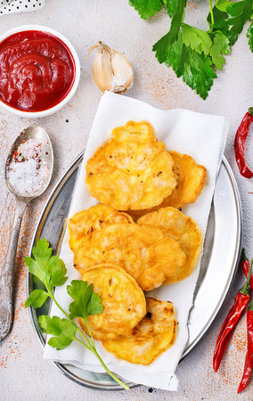 chicken cutlets on plate with tomato sauce