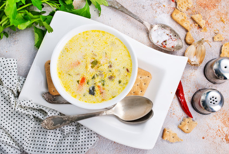 Cheese soup with mushrooms and fresh greens Stockfoto
