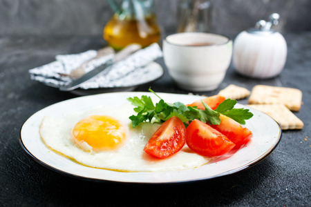 Breakfast on plate, fried eggs with vegetables Stock Photo