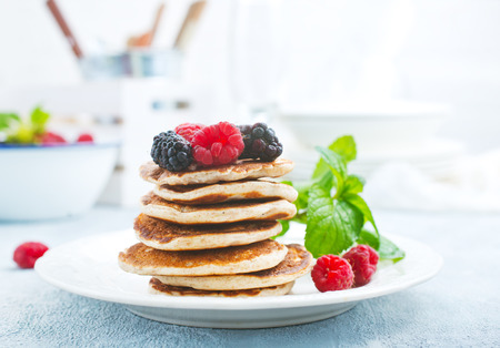 Pancakes with fresh berries on plate, stock photo Stock Photo