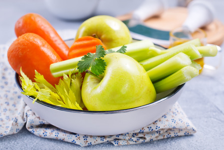 ingredients for diet salad, apples and celery and fresh carrots Stock Photo - 111184127