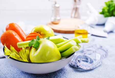 ingredients for diet salad, apples and celery and fresh carrots Stock Photo - 111182996