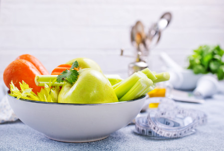 ingredients for diet salad, apples and celery and fresh carrots Stock Photo - 111182377