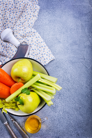 ingredients for diet salad, apples and celery and fresh carrots Stock Photo - 111182395