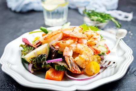 salad with fried shrimps on plate, fresh salad
