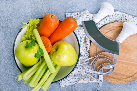 ingredients for diet salad, apples and celery and fresh carrots Stock Photo - 111181877