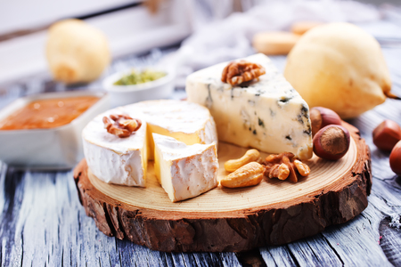 camambert cheese with dry almond on a table