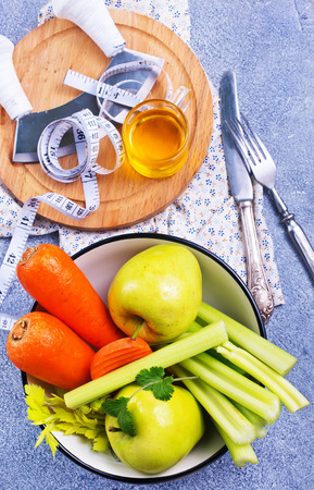 ingredients for diet salad, apples and celery and fresh carrots Stock Photo - 111181785