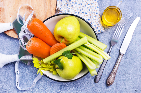 ingredients for diet salad, apples and celery and fresh carrots Stock Photo - 111181786