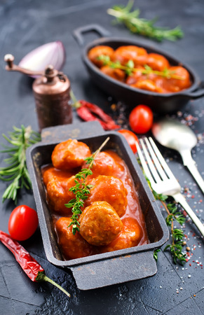 Meatballs with tomato sauce in metal bowl