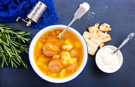 Soup with vegetables and meatballs in bowl