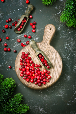 Cranberry on wooden table, fresh cranberry