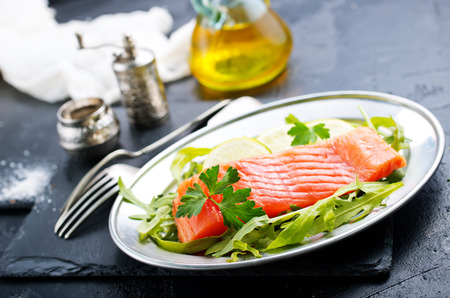 Salmon fish with fresh salad on plate