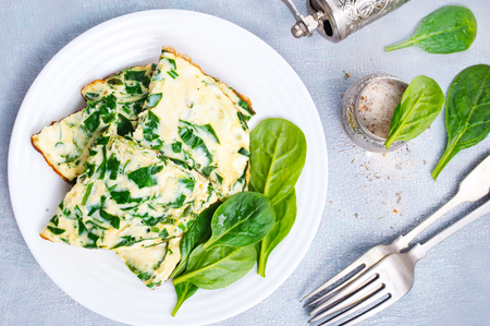 Omelette with spinach on plate, egg omelette 스톡 콘텐츠