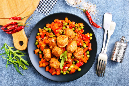 Vegetables with tomato sauce and meat balls