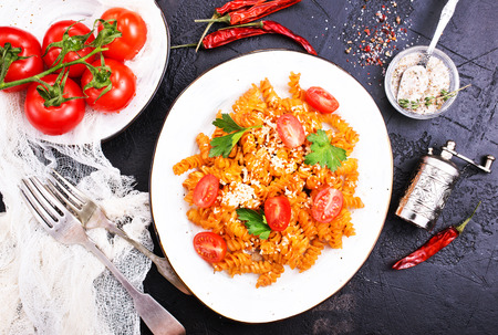 Boiled pasta with tomato sauce and grated cheese