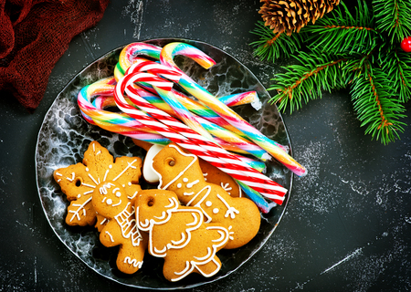 Cookies and candy cane on a table, christmas