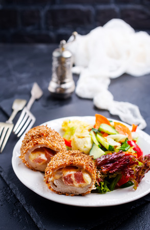 Meat cutlet cordon bleu, cutlet with fresh salad on plate