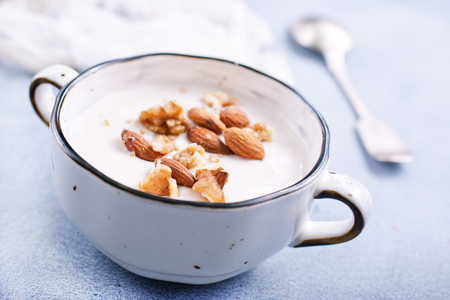 Sour cream with sugar and nuts, desert with nuts Stock Photo - 113555405
