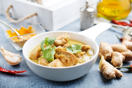 Chicken curry in white bowl on a table